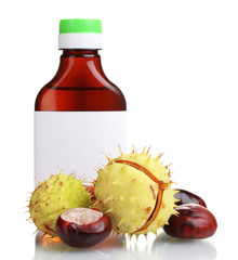 green and brown chestnuts and medical bottle isolated on white