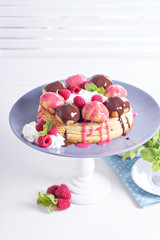Saint-Honore cake with chocolate and raspberry