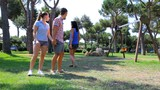 Woman slapping boyfriend looking other girl in park