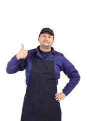 Worker wearing black apron.
