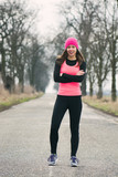 woman running outdoors training for marathon run