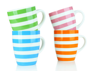 Color empty mugs isolated on white