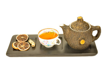 cup of aromatic tea and teapot  isolated