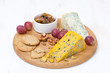 assorted cheeses, grapes, crackers, jam and nuts