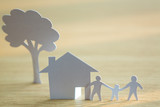 Paper cut of family with house and tree