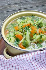 egetable soup with cabbage, broccoli, potatoes and carrots