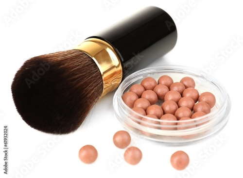 Cosmetic brush and brown rouge isolated on white