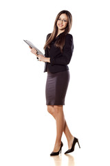 young business woman posing with a clipboard in her hands
