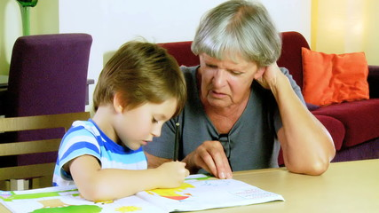 Happy child showing grandmother homework