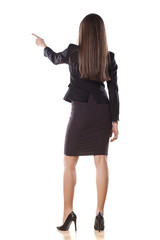 rear view of young business woman pointing with her finger