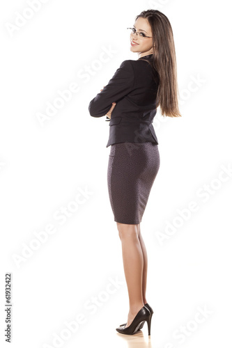 young business woman with arms crossed on white background
