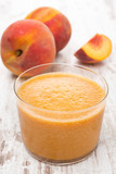 fresh squeezed peach juice and fresh peaches, close-up