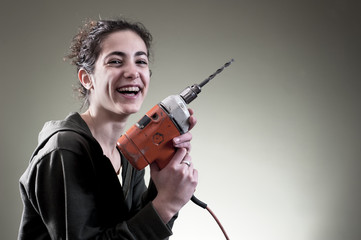 Happy young female working with drill