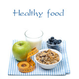 healthy food - apple, blueberry, water and muesli, isolated