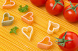 spaghetti and pasta in the form of heart, selective focus