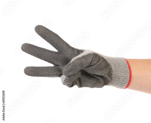 Hand shows three in rubber glove.