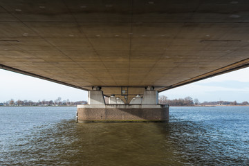 Underside of a long bridge in the Netherlands