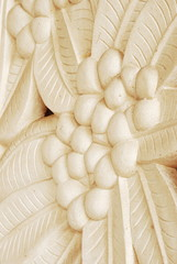 Sand stone Bas-relief of frangipani flower, Thailand