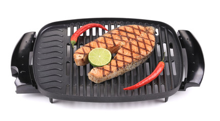 Grilled salmon steak on grill.