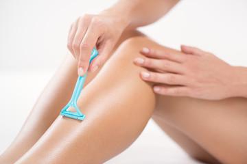 Shaving legs with Razor.