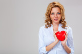 woman holding red heart symbol