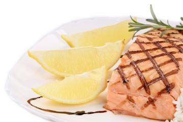 Lemon slices and salmon fillet.