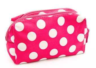 Pink cosmetic bag isolated on a white