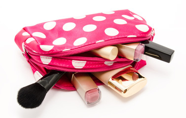 Pink make up bag with cosmetics isolated on a white