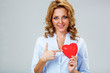 seriuosly woman holding red heart symbol