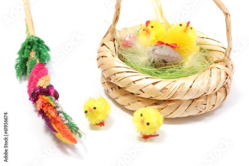 Easter chickens in wicker basket and colorful palm