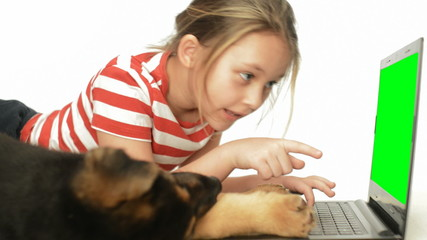 girl typing on laptop keyboard with green screen