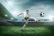 canvas print picture - Soccer player with ball in action outdoors.