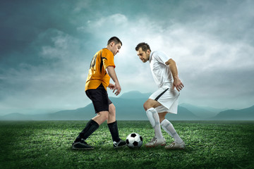 Soccer players with ball in action outdoors.