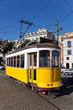 Leinwanddruck Bild - Iconic 100 year old Lisbon's yellow tram