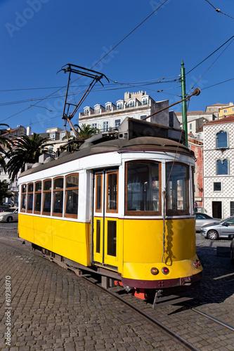 Leinwanddruck Bild Iconic 100 year old Lisbon's yellow tram
