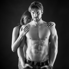Confident couple close up intimate studio portrait. Black and wh