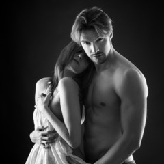 Young couple close up intimate studio portrait in a romantic moo