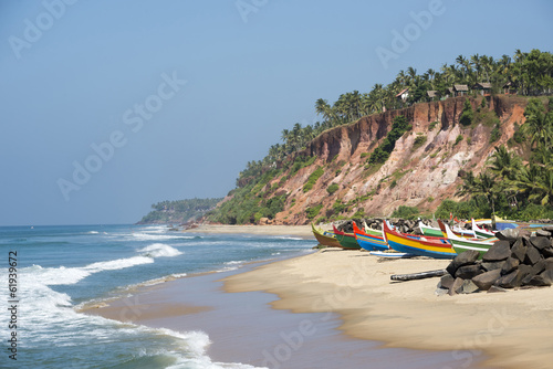 Tropical beach with fishing boats