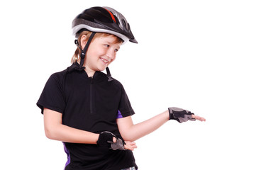 Boy cyclist pointing with his hand to the copy space
