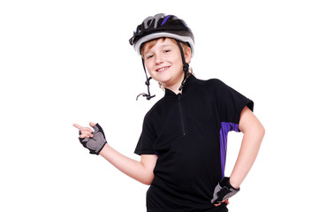 Boy cyclist pointing with his finger to the copy space