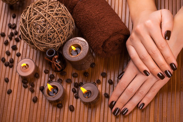 beautiful brown manicure on a bamboo background