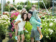 family having fun with in a greenhouse