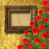 Vintage wooden frame with red rose and green leaves on the gold