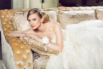 Bride lying on sofa
