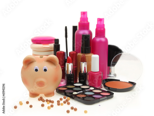 Piggy bank with various cosmetics isolated on white background