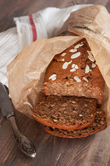 Freshly baked banana bread with almond in baking paper