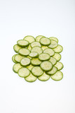 Freshly sliced cucumber  isolated on white background