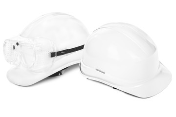 two white hard hats