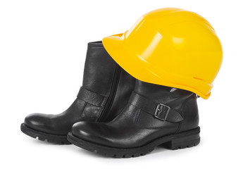 Yellow hard hat and boots over white