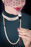Restaurant fashion image with nail art, red lips, and pearl
